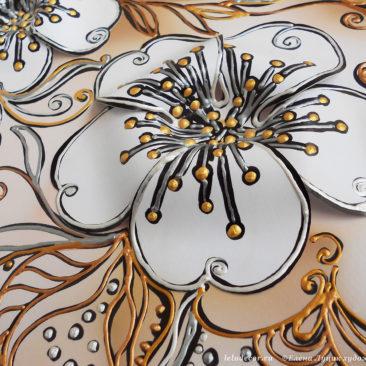 фрагмент объемной декоративной картины с цветком вишни